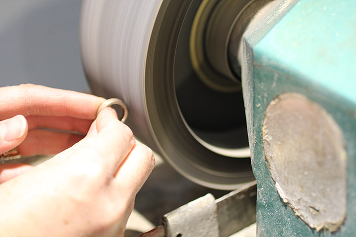 After the ring is hammered into shape, it is polished on our polishing wheel.