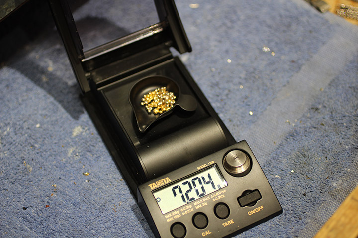 24K Fairtrade Gold grain being weighed out before it is formed into a wedding ring.