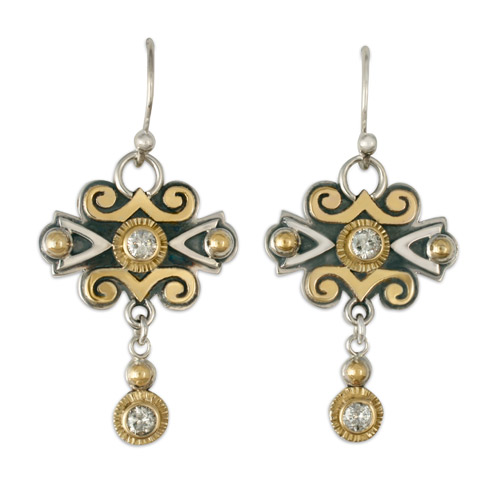 These custom earrings are a variation on our Cascade Earrings. We substituted diamonds for garnets, and crafted custom gold mounts.