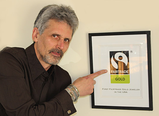 Marc Choyt, President and co-owner of Reflective Jewelry, poses with our Fairtrade Gold certification.