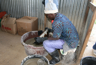 This miner is using safe methods to ensure he does not directly handle mercury.