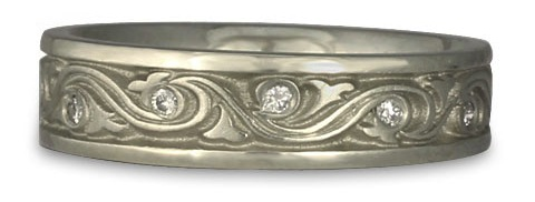 Our Wind and Waves Wedding Ring is shown here in Platinum and adorned with diamonds.