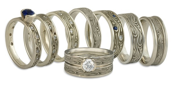 These white gold engagement rings and wedding rings all feature the same motif, executed differently. As custom jewelers, we can always vary your ring in ways that suit you!